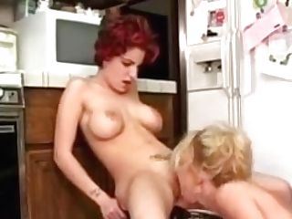 Lezzie Fake Penis Fucking In The Kitchen